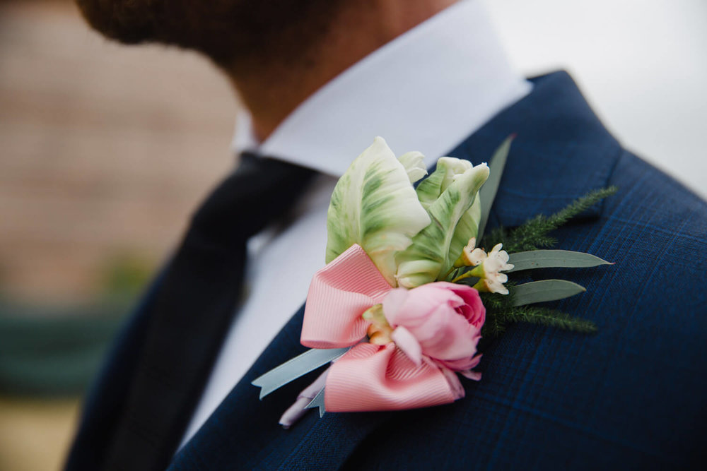 close up of pinhole flower on bespoke suit lapel