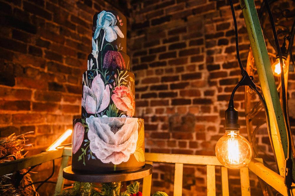 marie antoinette wedding cake lit up by festoon lighting