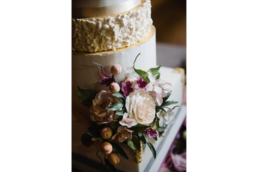 close up portrait photograph of floral rose on cake