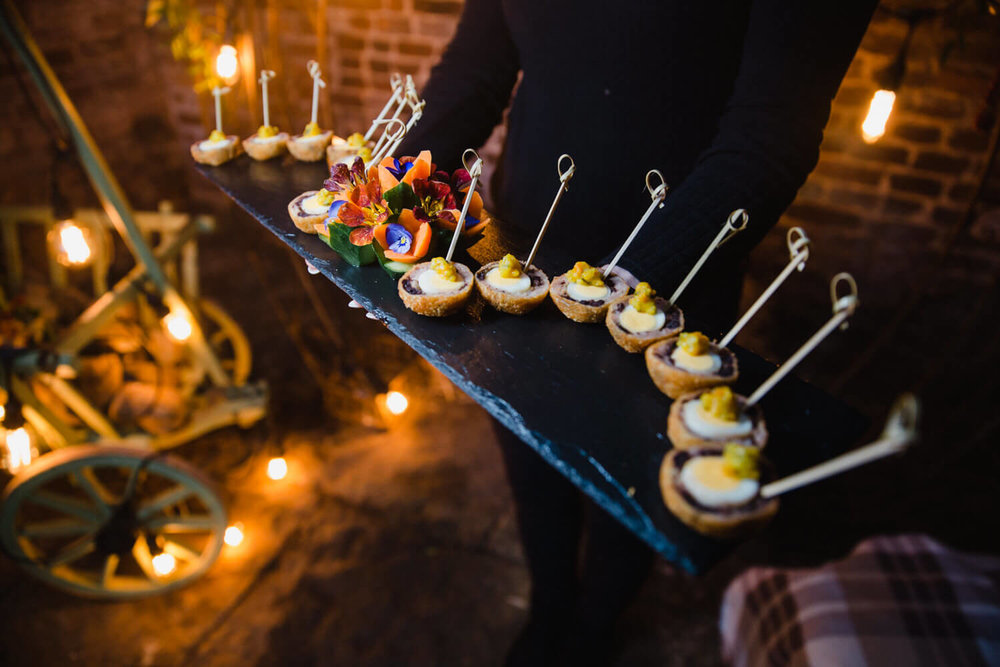 Top Table Weddings and Events serve food