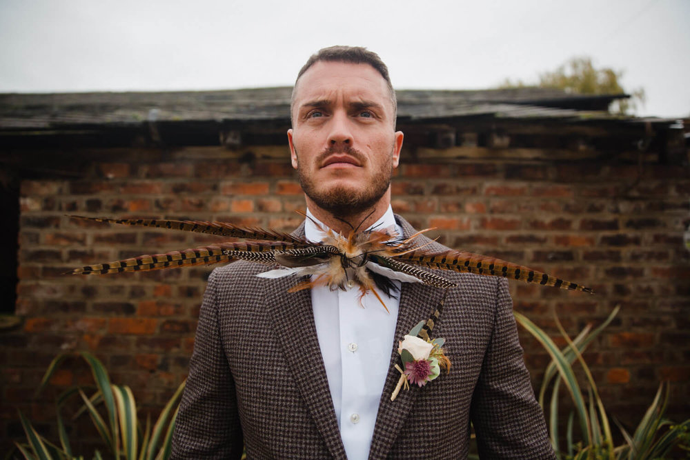 Pheasant Feather Bow Tie worn by Groom