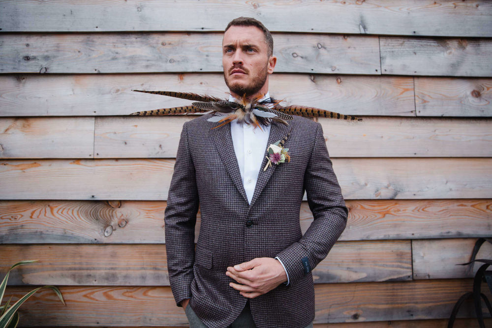 Groom Portrait in front of wooden fence