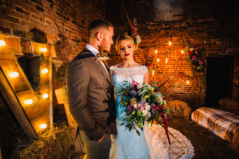 bride and groom at stock farm barn wedding