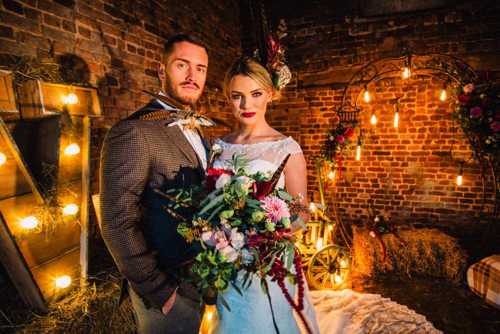 portrait of wedding couple holding bouquet