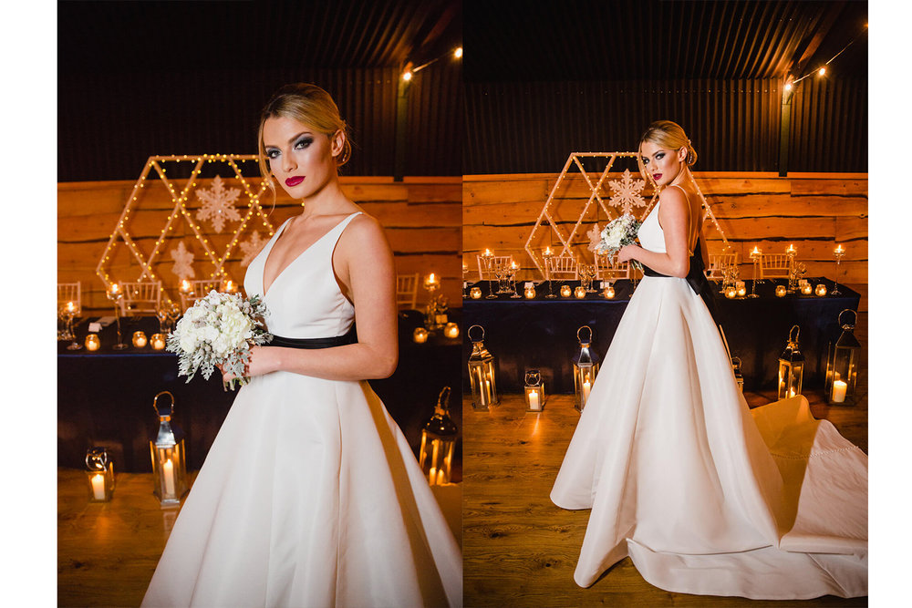 bride posing with backdrop of candles and lights