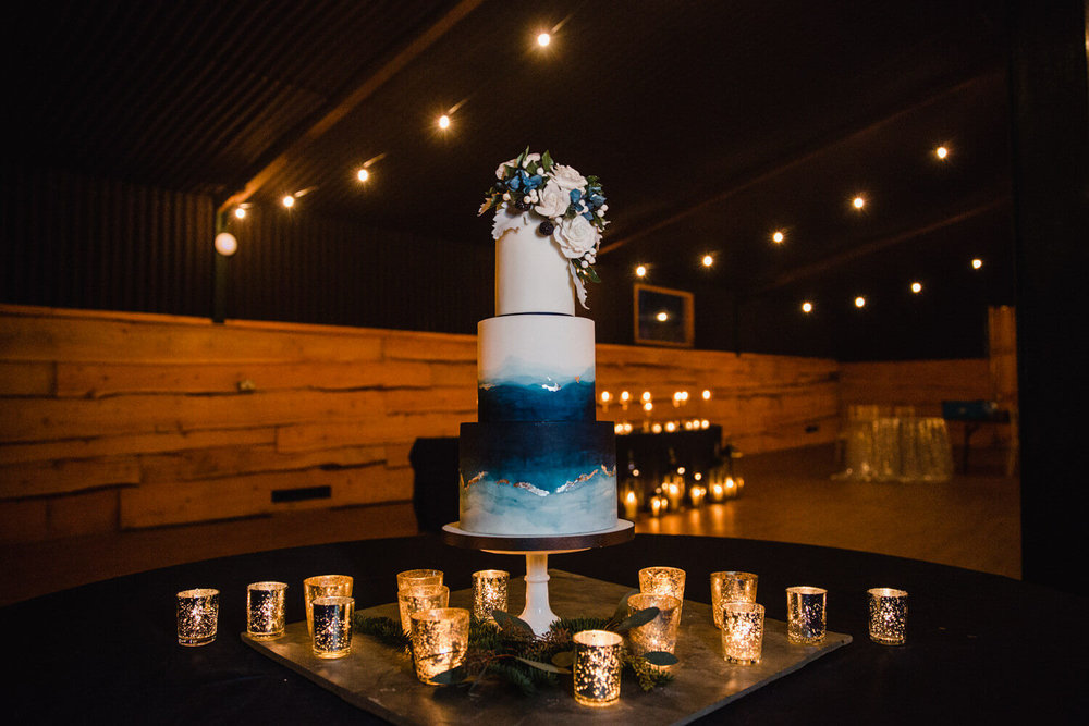 marie antoinette wedding cake sat on table