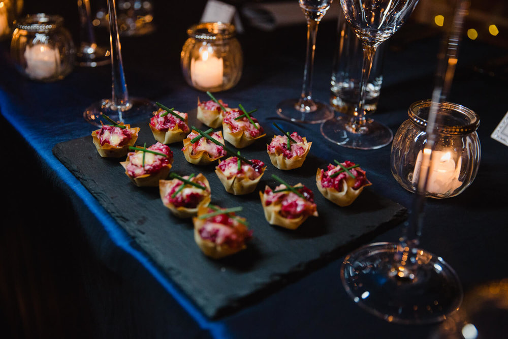 top table canapés on blue cloth