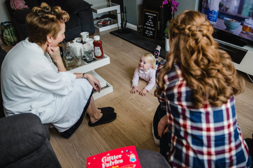 flower girl baby on the floor with mum