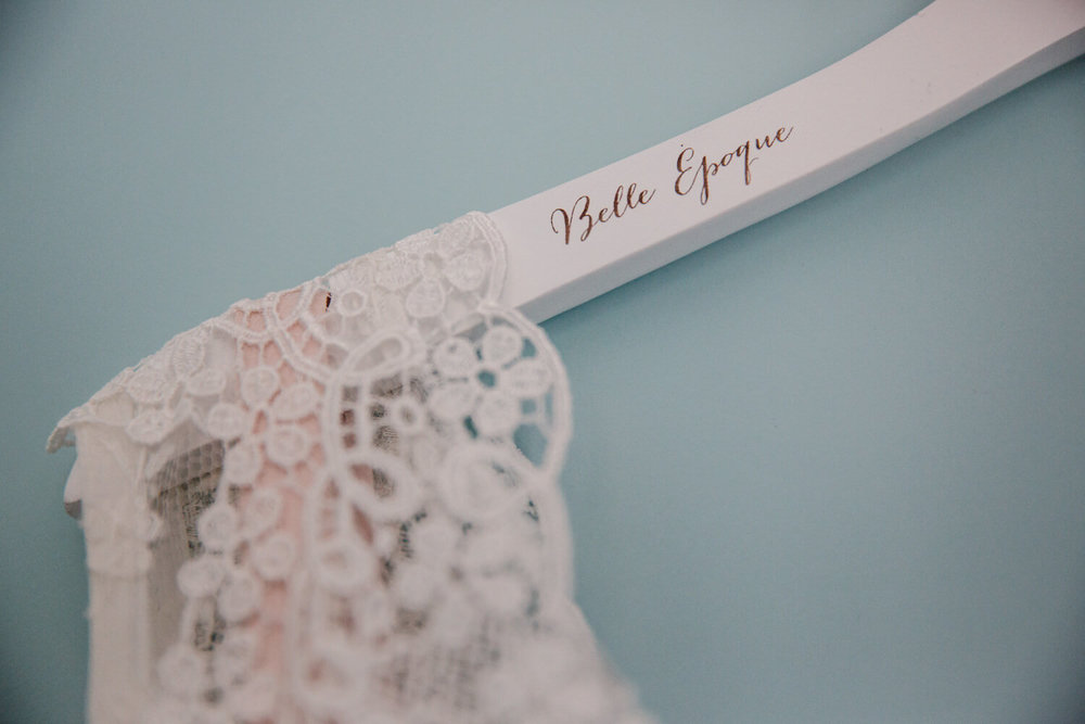 close up of belle epoque labelled wedding dress hanger