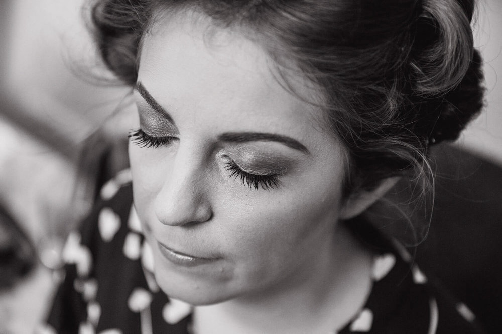 black and white close up of brides eyelash make up