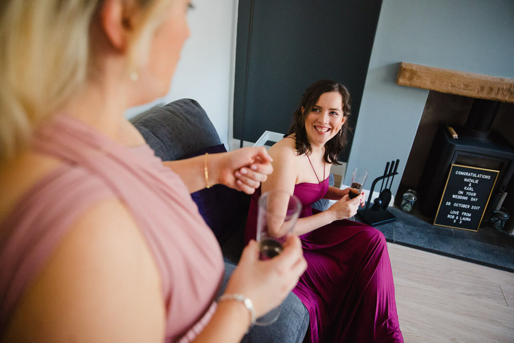 bridesmaids talking in living room