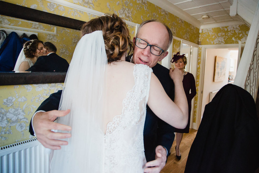 intimate moment of father daughter hug