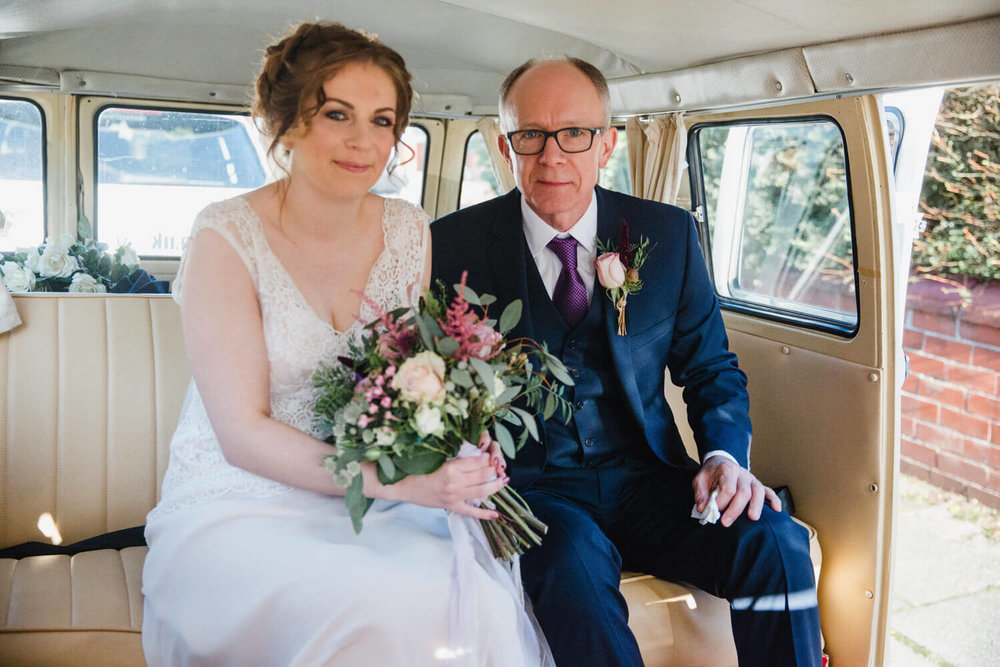 bride and father in VW campervan