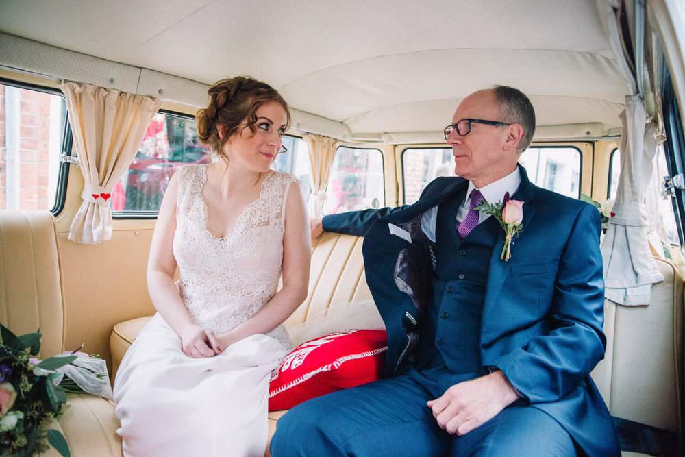 bride and father sat in VW campervan wedding car