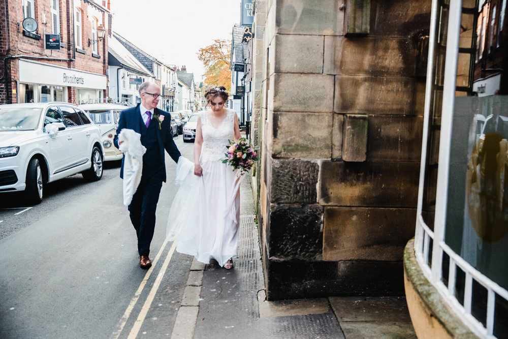 bride and father walking down King Street in Knutsford