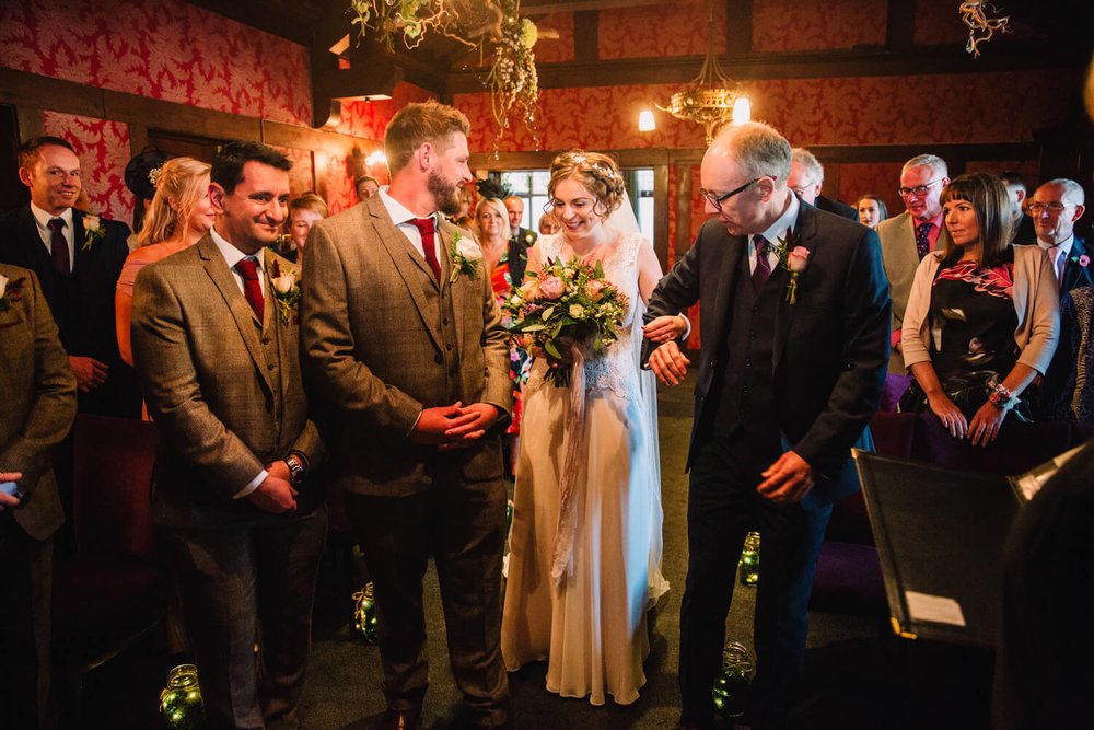 bride meets groom at the top of the aisle to begin marriage service