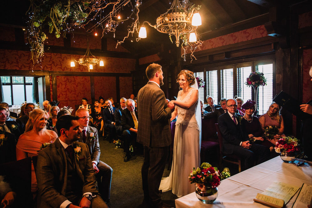 bride and groom exchange wedding rings at the belle epoque in knutsford