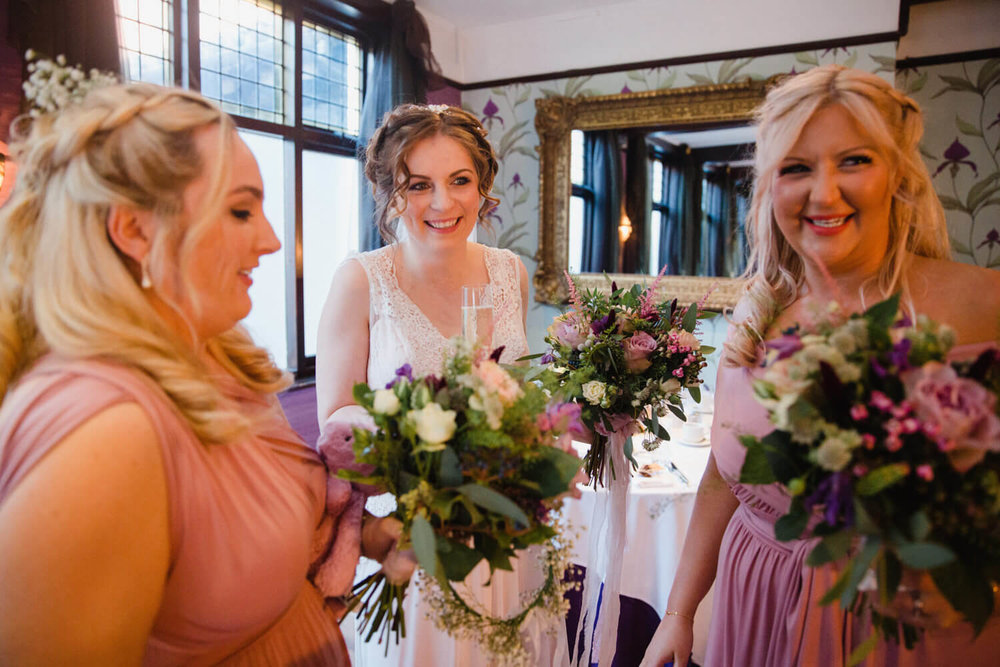 bride laughing and smiling with bridesmaids