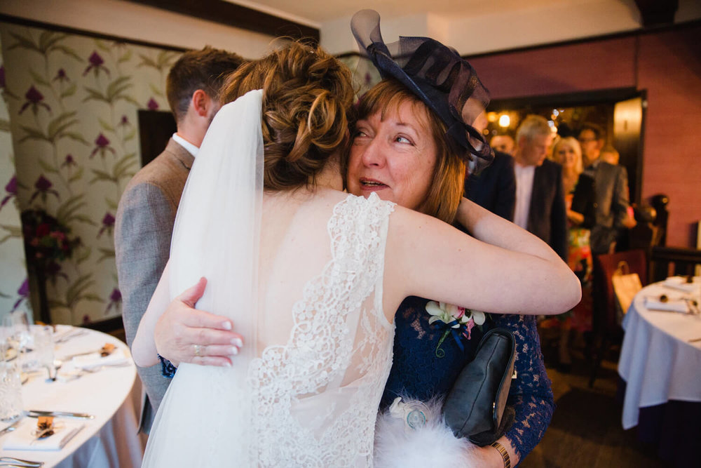 bride hugging auntie after ceremony