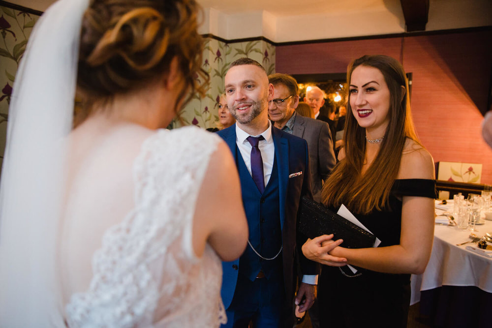 wedding guests congratulating bride and groom
