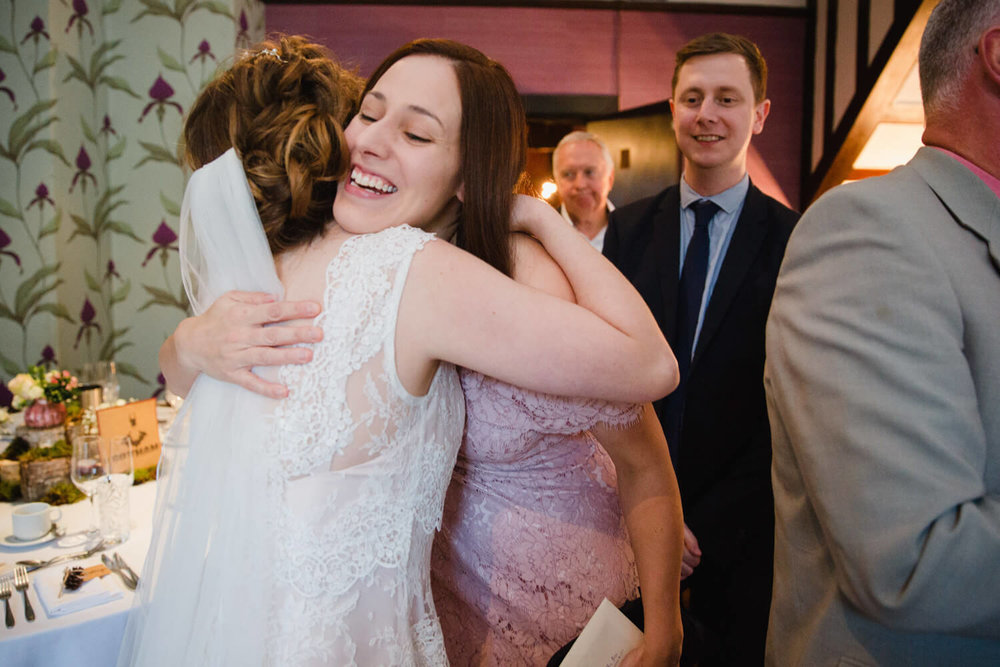 brides friend shares an intimate hug