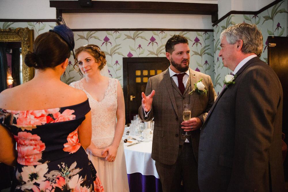newlyweds greeting family