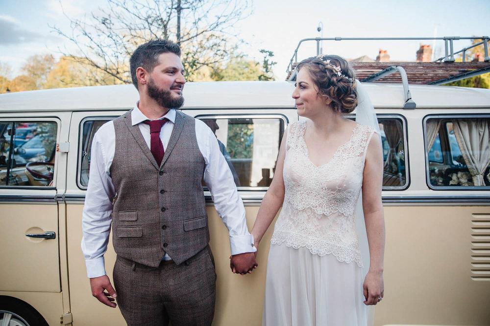 bride and groom portrait in front of VW campervan