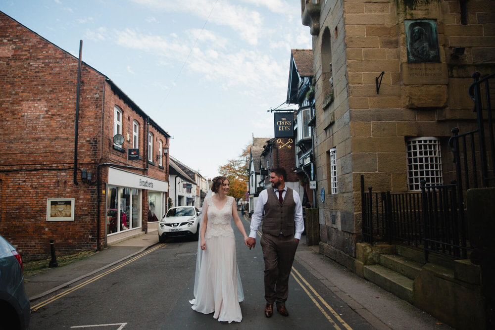 newlyweds portrait walking down king road
