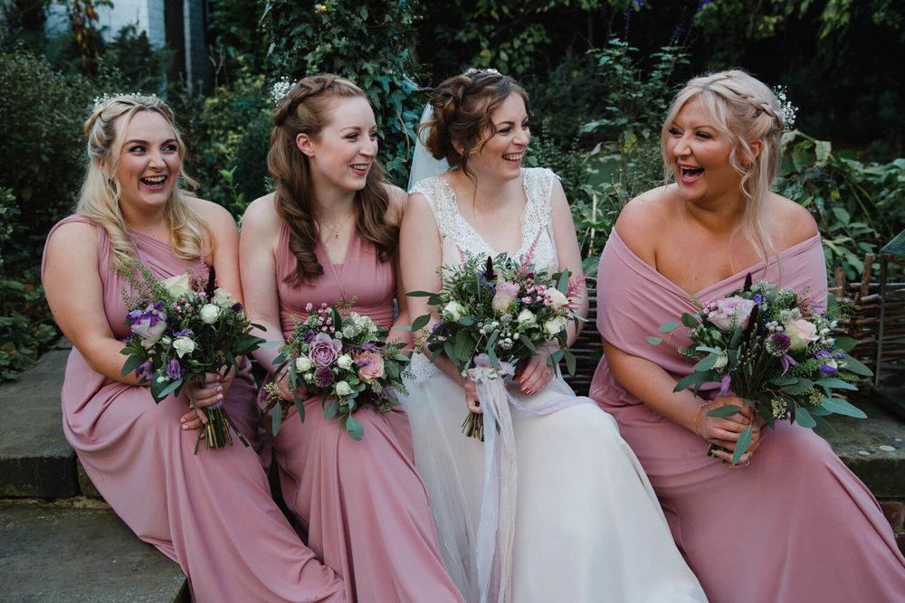 bridesmaids laughing and joking