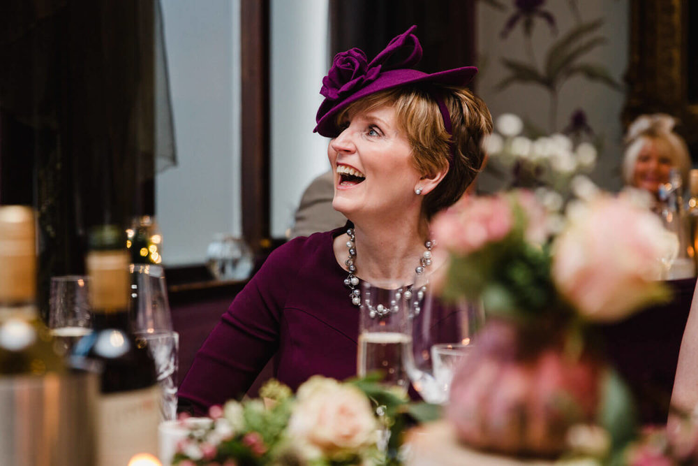 mother of groom laughing at speeches