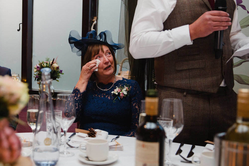 mother of groom wiping away tears