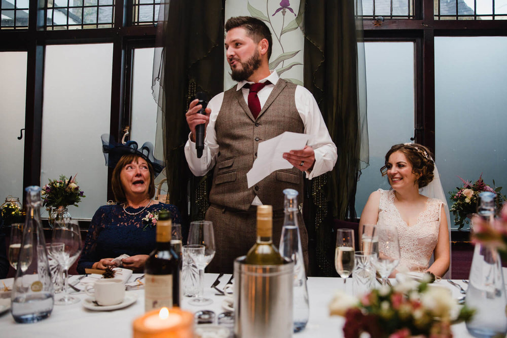 close up of groom giving speech to party