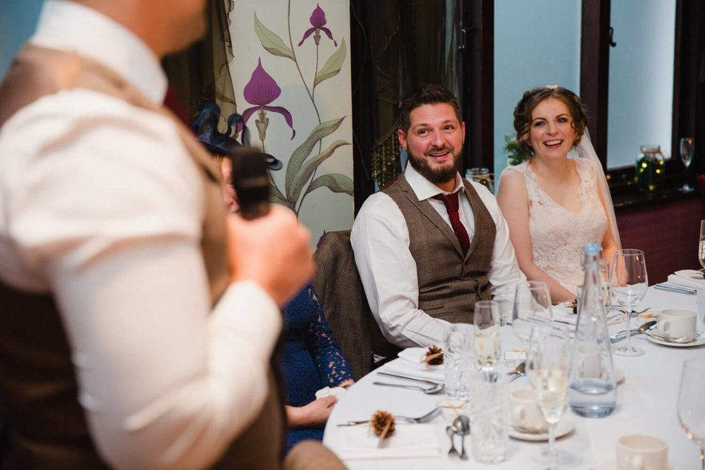 close up of newlyweds at top table