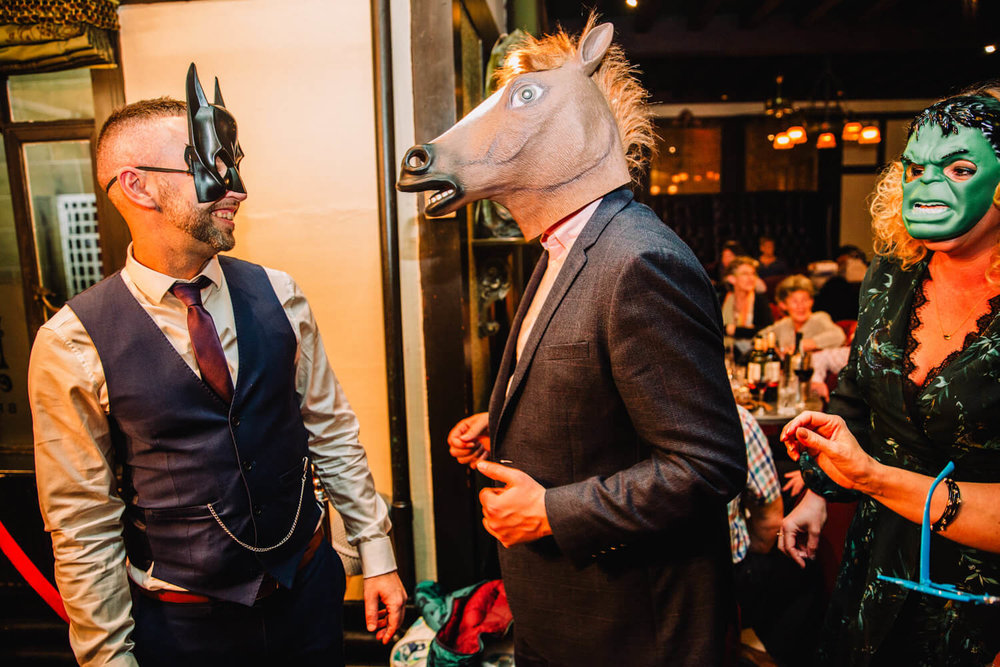 wedding guests wearing photo booth masks