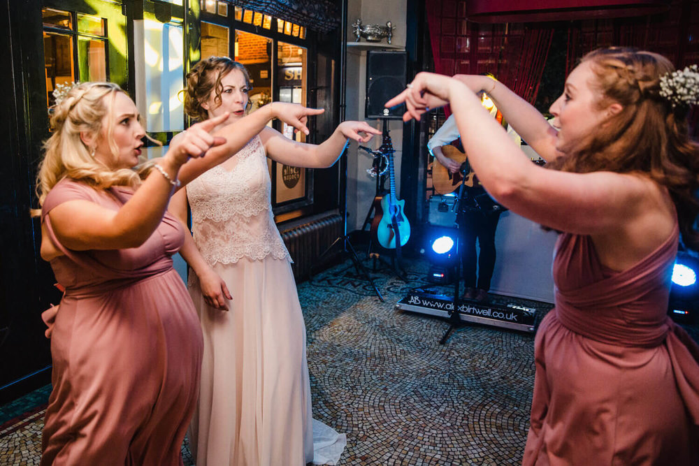 bridal party all dancing together to music on dancefloor at belle epoque
