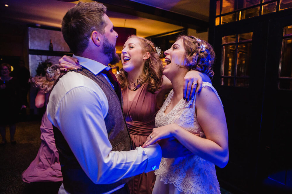 newlyweds and bridesmaids dancing to alex birtwell wedding entertainment at belle epoque