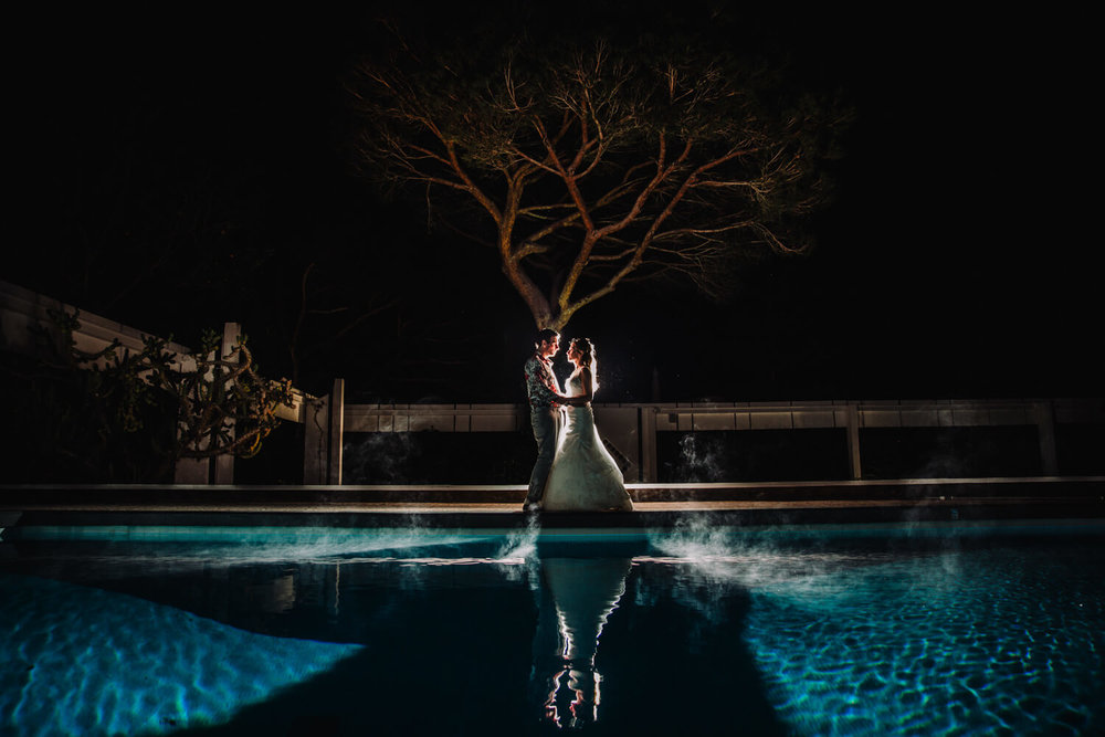 bride and groom poolside portrait in vilamoura