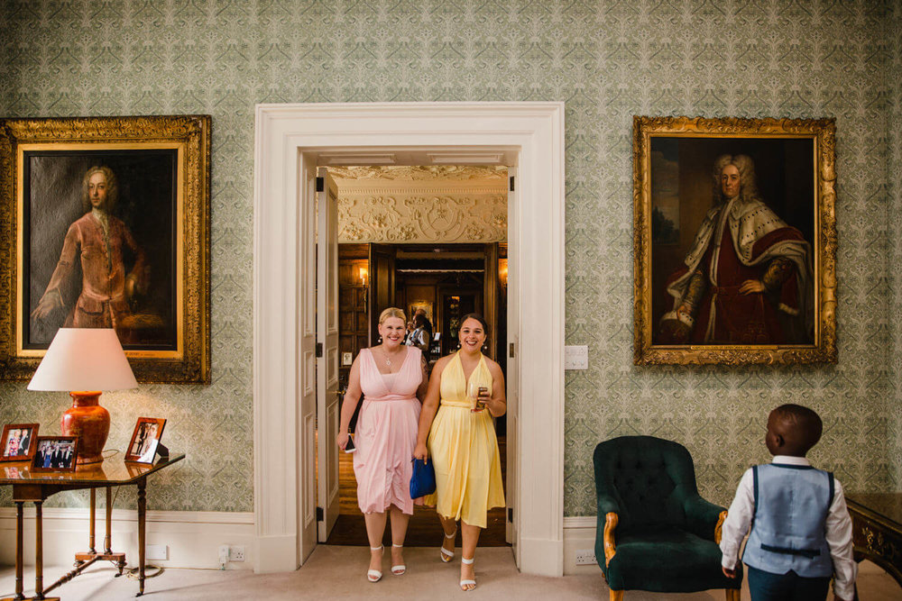 bridesmaids walking together through doorway at knowsley hall