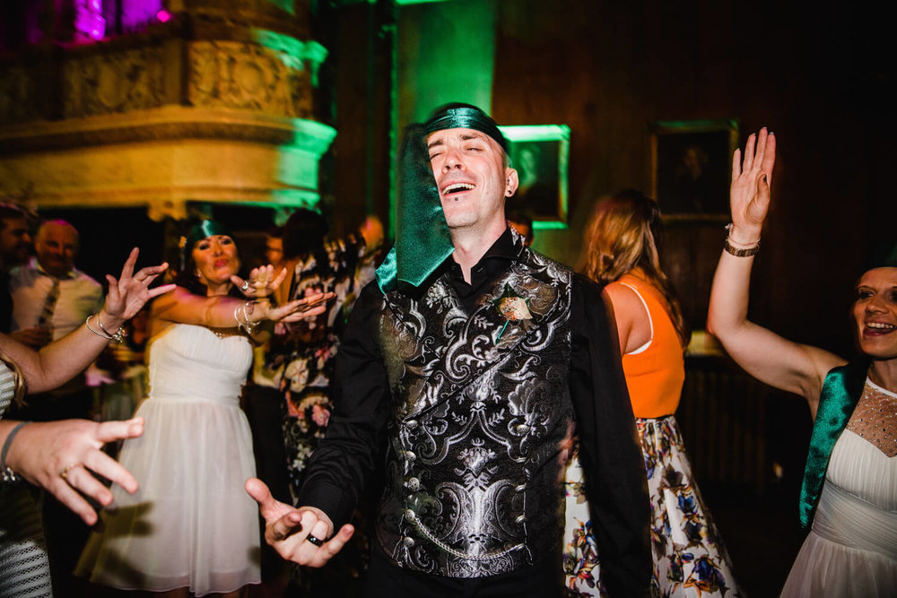 groom dancing with tie on his head