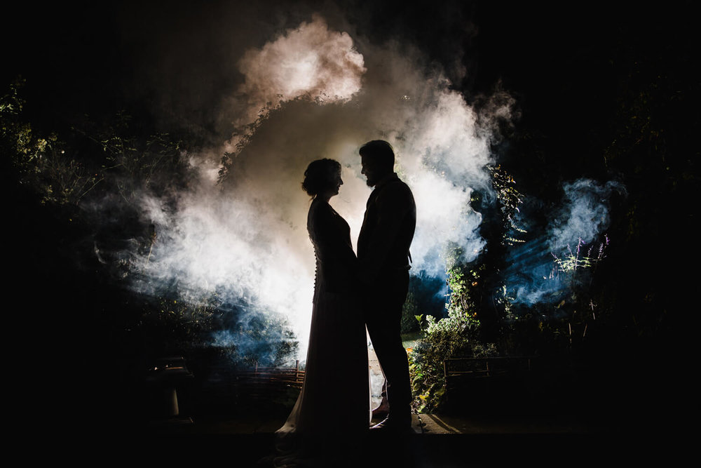 bride and groom smoke grenade silhouette