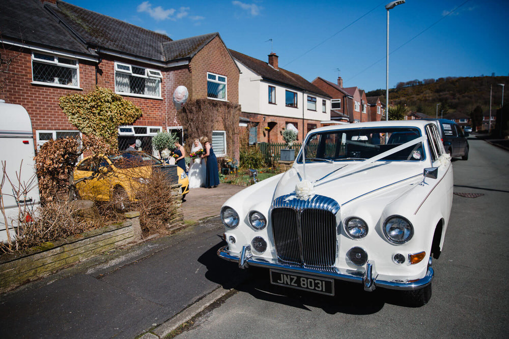 wedding car arrives to take bridal party to ceremony