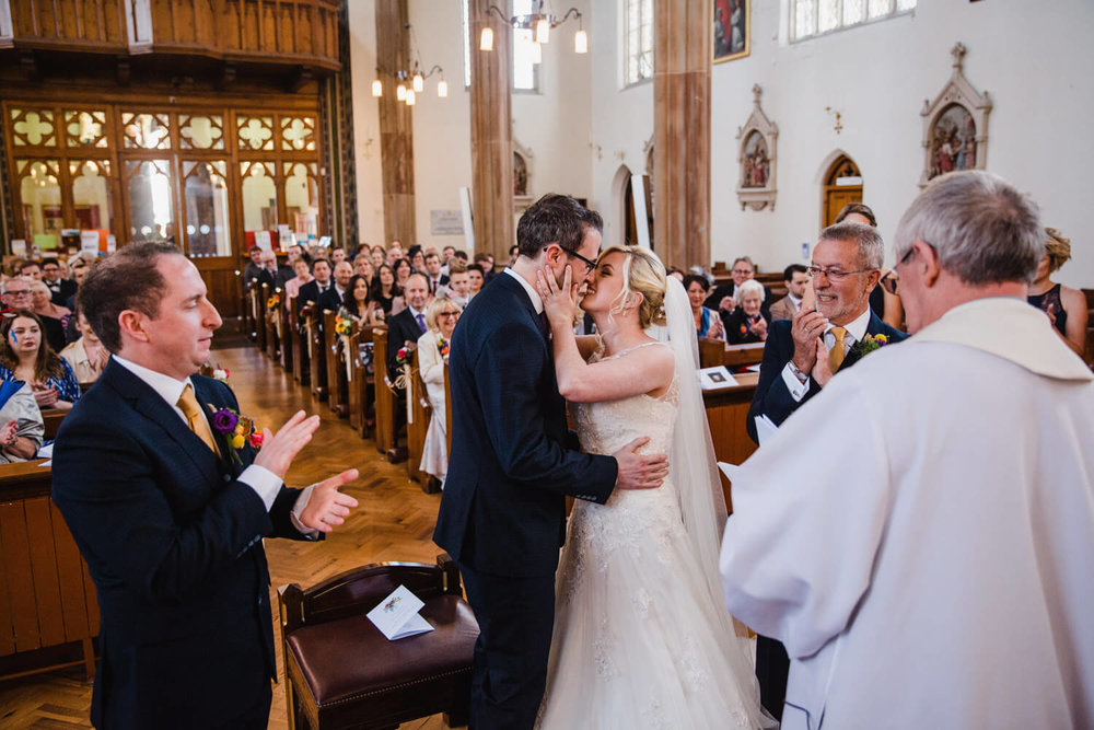wide angle photograph of bride and groom married at St Albans Church in Macclesfield