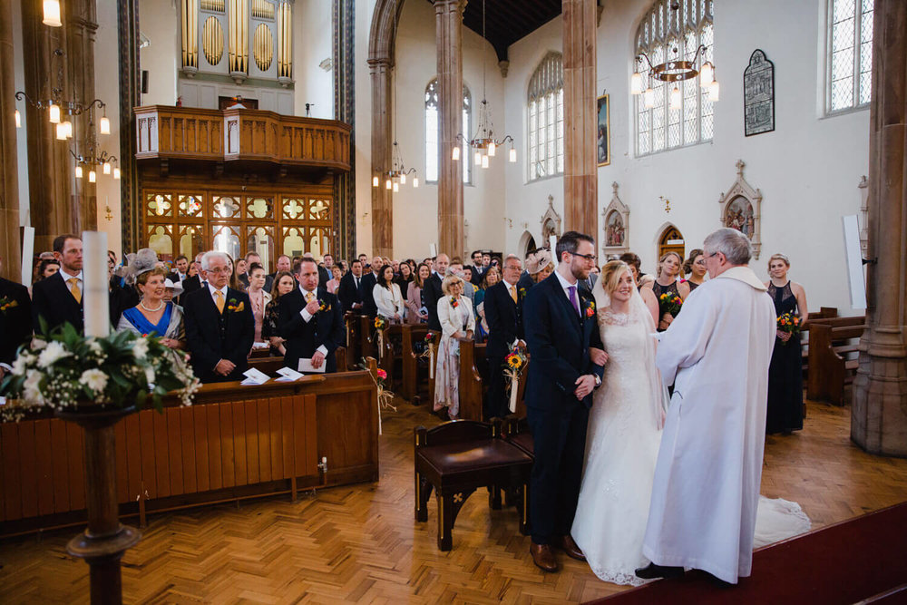 wide angle photograph of ceremony at St Albans church Macclesfield