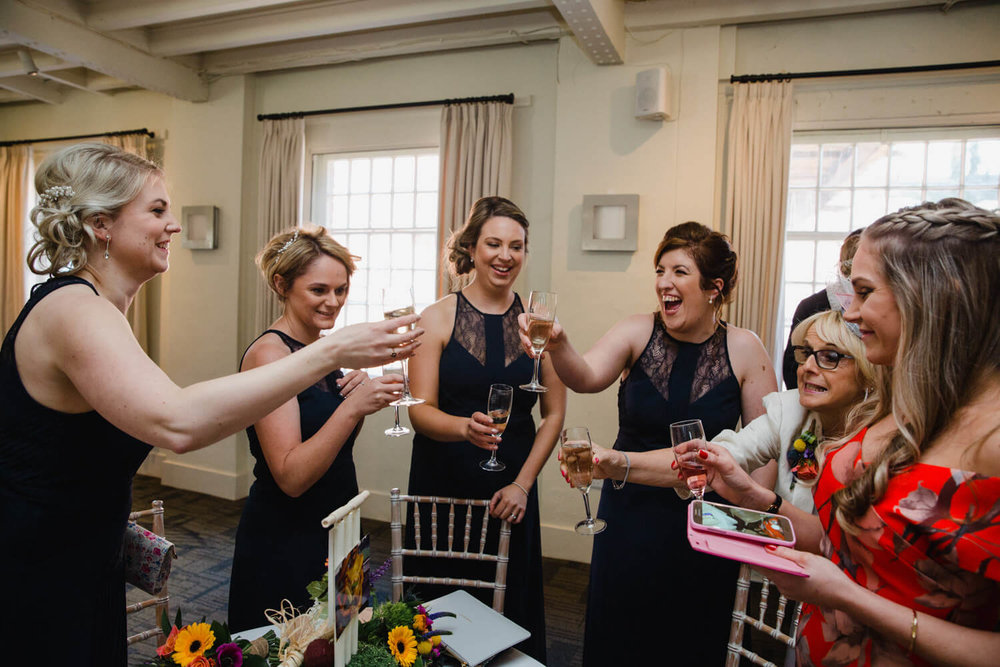 bridesmaids sharing drinks at reception