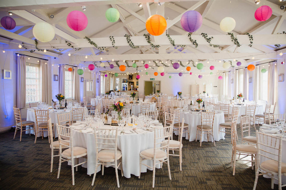 wedding reception layout with bunting and colourful balloons