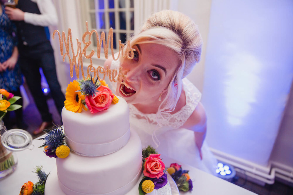 bride pretending to eat cake close up