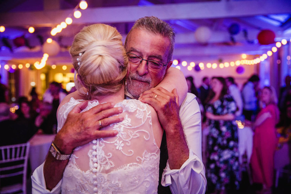 intimate moment with father and bride on dance floor