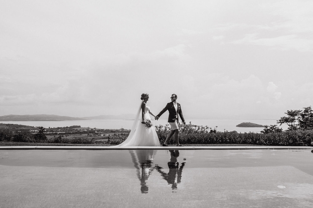 Nic and Phil taking a stroll by the infinity pool overlooking Lake Trasimeno, Tuscany.
