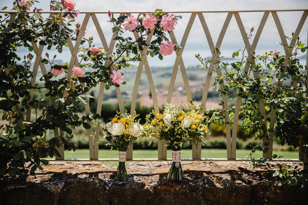wedding bouquets on terrace overlooking tuscany