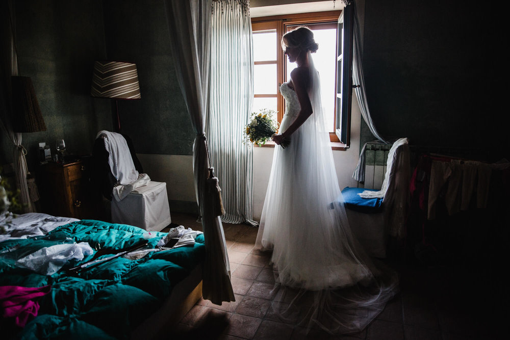 bride silhouette portrait in window of bedroom